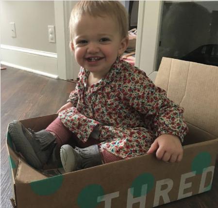 cute kid in thredUP box